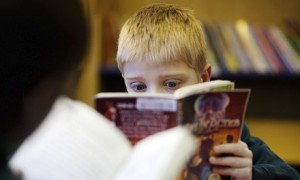 A child reading in the library at a primary school in the UK